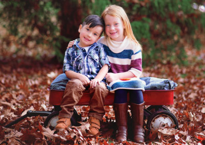 children-photographer-puyallup-tacoma-wright park-fall-red wagon- sibling
