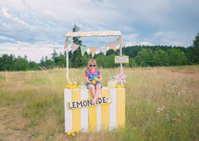 girl, children, lemonade stand, field, summer, 3 year old, make up, lemons (10 of 24)