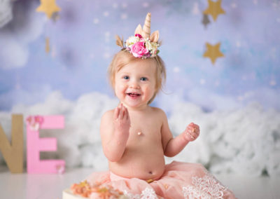 puyallup child photographer newborn grow with me cake smash unicorn cake clouds studio-18