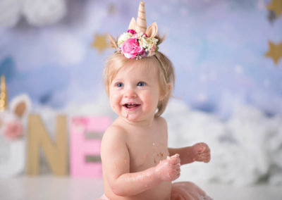puyallup child photographer newborn grow with me cake smash unicorn cake clouds studio-24