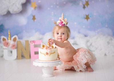 puyallup child photographer newborn grow with me cake smash unicorn cake clouds studio-4